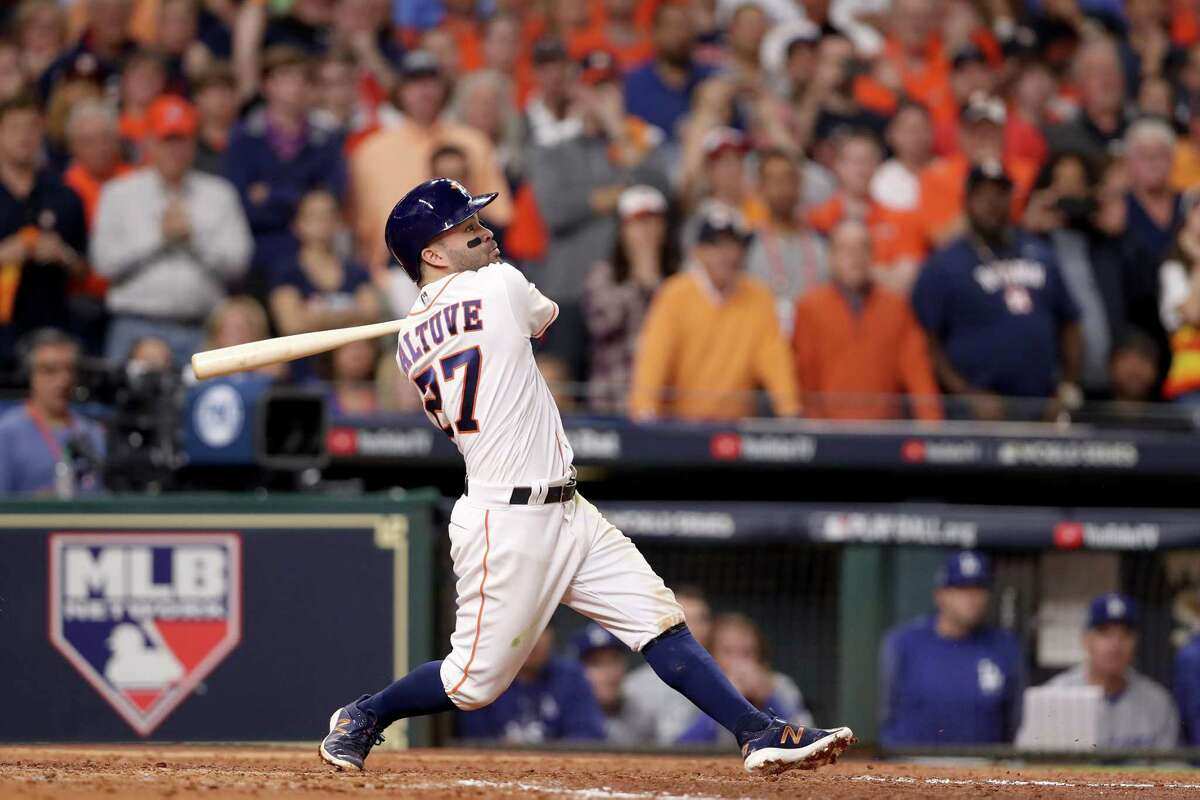 HOUSTON, TX - OCTOBER 29: Jose Altuve #27 of the Houston Astros hits a three-run home run during the fifth inning against the Los Angeles Dodgers in game five of the 2017 World Series at Minute Maid Park on October 29, 2017 in Houston, Texas. (Photo by Christian Petersen/Getty Images) ORG XMIT: 775063340