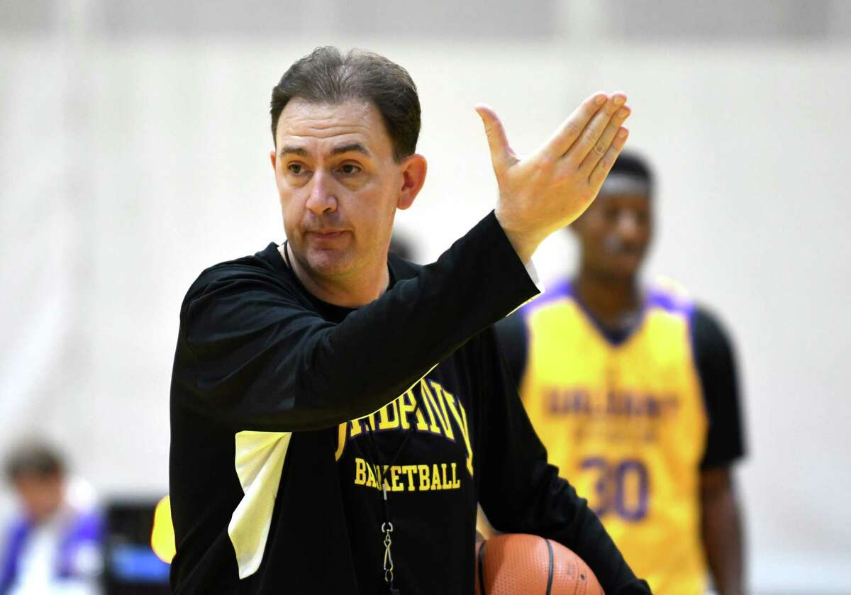 University at Albany men's basketball coach Will Brown works with players during a practice at SEFCU Arena on Monday, Oct. 9, 2017, in Albany, N.Y. (Will Waldron/Times Union)