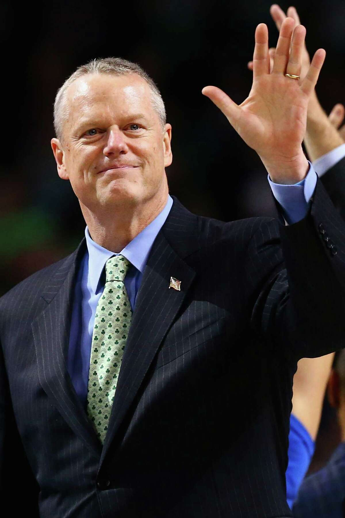 BOSTON, MASSACHUSETTS - APRIL 06: Massachusetts Governor Charlie Baker waves to the crowd during the second quarter of the game between the Boston Celtics and the New Orleans Pelicans at TD Garden on April 6, 2016 in Boston, Massachusetts. (Photo by Maddie Meyer/Getty Images) ORG XMIT: 575732235