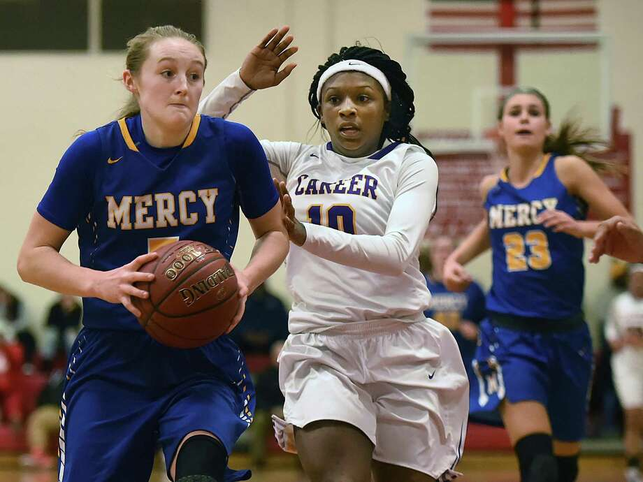 Mercy senior guard Bella Santoro drives the paint as Career sophomore forward Arkaysee Booker defends, Wednesday, Dec. 27, 2017, at the third annual Robert Saulsbury Invitational at Saulsbury gymnasium at Wilbur Cross High School in New Haven. Photo: Catherine Avalone / Hearst Connecticut Media / New Haven Register