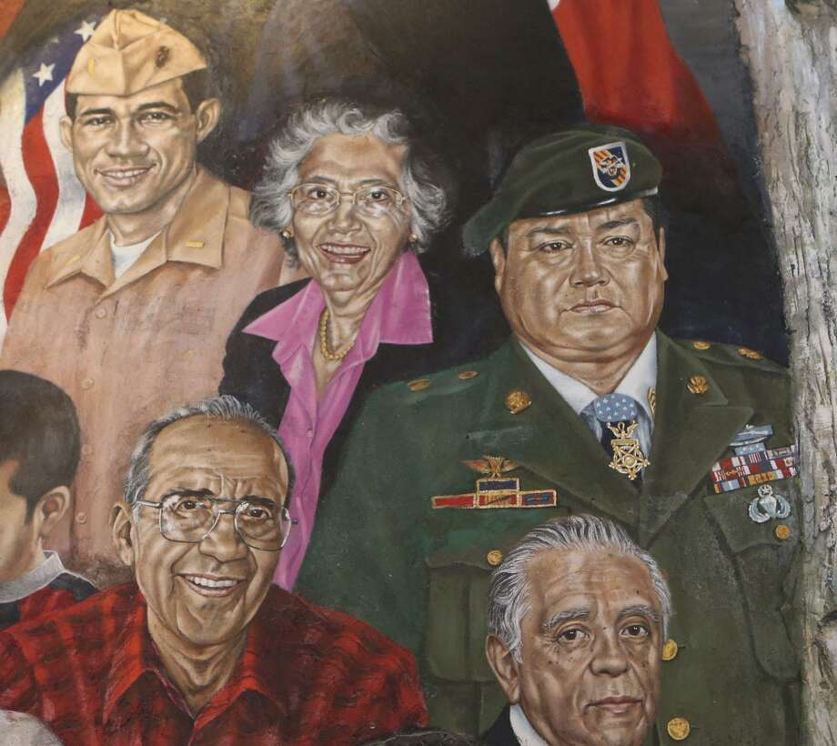 A mural at Mi Tierra restaurant features portraits of prominent people from San Antonio or with ties to San Antonio, South Texas and Mexico. Some of the portraits feature Hispanics with ties to the military such as Master Sergeants Cleto Rodriguez (not pictured) and Roy P. Benavidez (upper right). Also featured is U.S. Rep. Frank Tejeda (upper left), a decorated veteran of the Vietnam War. Photo: John Davenport, STAFF / San Antonio Express-News / ©John Davenport/San Antonio Express-News