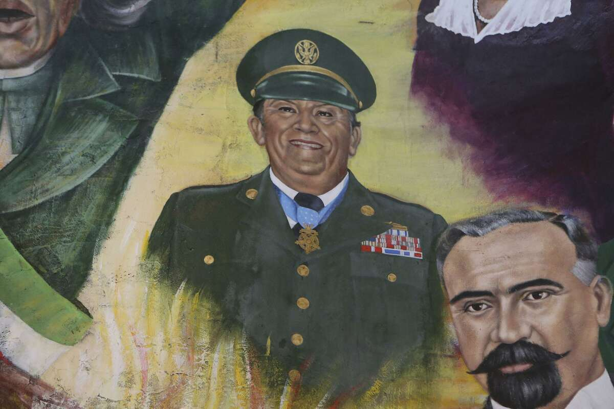 A mural at Mi Tierra restaurant features portraits of prominent people from San Antonio or with ties to San Antonio, South Texas and Mexico. Some of the portraits feature Hispanics with ties to the military such as Master Sergeants Cleto Rodriguez (center).