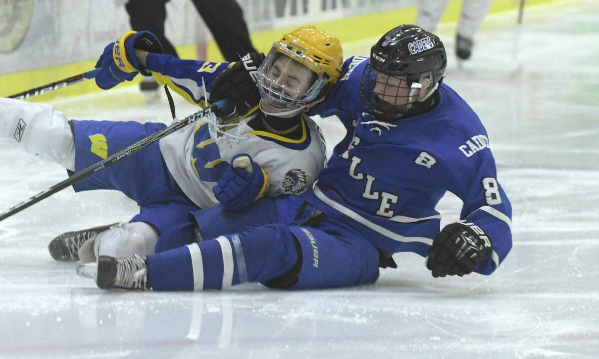 Billy Coughlin of West Seneca West, left, is taken down by Tom Ryan of LaSalle Institute during their hockey game on Wednesday, Dec. 27, 2017, in Schenectady, N.Y. (Paul Buckowski / Times Union)
