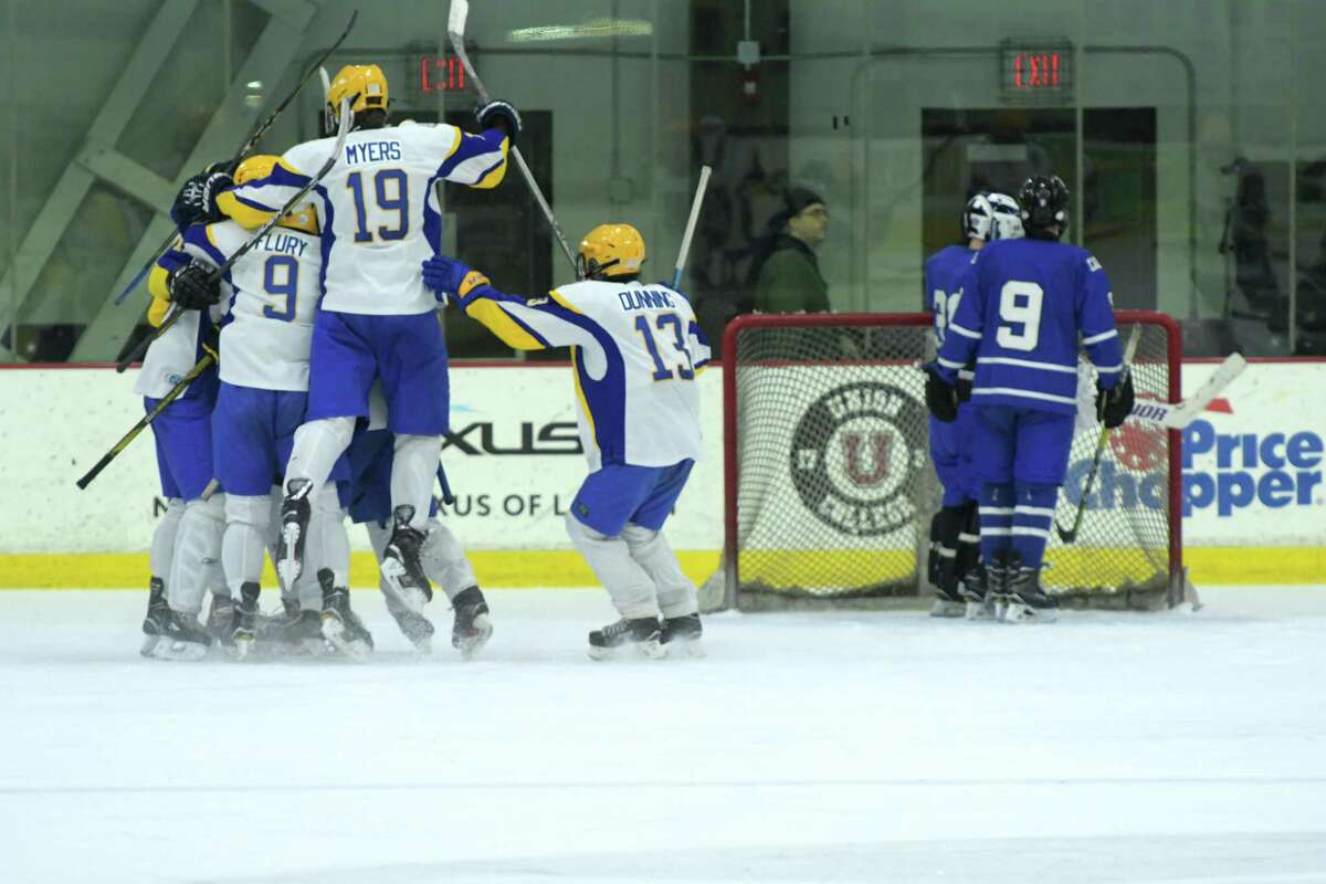 West Seneca West players celebrate their overtime goal to win against LaSalle Institute on Wednesday, Dec. 27, 2017, in Schenectady, N.Y. (Paul Buckowski / Times Union)