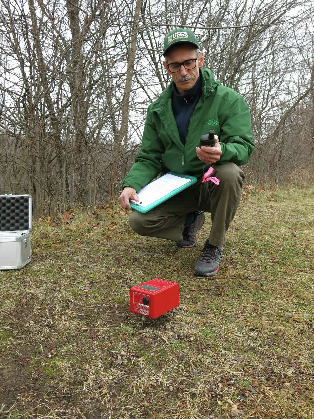 Paul Heisig, a hydrologist with the U.S. Geological Survey, uses a portable seismic unit to measure the underground aquifer at Moreau Lake State Park. (U.S. Geological Survey)
