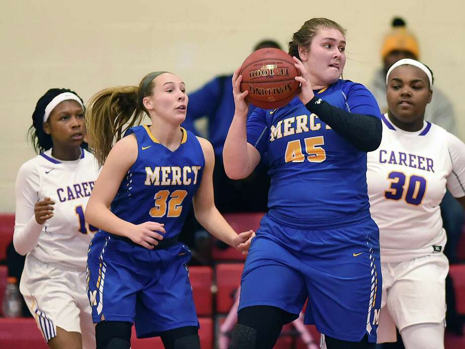 Mercy senior Meg Deville grabs a rebound against Career, Wednesday, Dec. 27, 2017, at the third annual Robert Saulsbury Invitational at Saulsbury gymnasium at Wilbur Cross High School in New Haven. Mercy won, 53-34. Photo: Catherine Avalone, Hearst Connecticut Media / New Haven Register