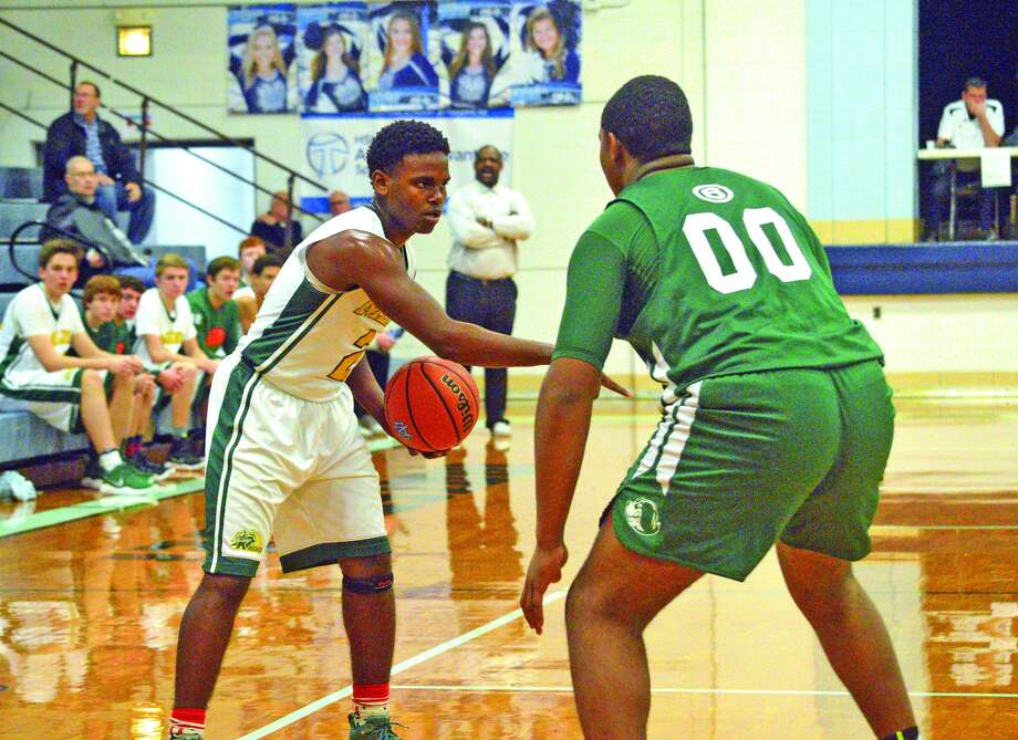 Metro-East Lutheran senior Darion Brooks, left, tries to work his way past a Briarcrest Christian defender during the second quarter of Wednesday's game at the Mater Dei Christmas Tournament.