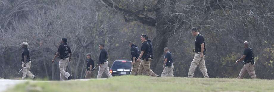 Officers search a field Friday near the Pecan Grove Manufactured Home Community in Schertz where 6-year-old Kameron Prescott was shot. Prescott was fatally wounded while inside his home in the 100 block of Peach Lane when four Bexar County sheriff's deputies opened fire on a wanted felon after she broke into Prescott's home. Photo: Express-News File Photo / ©John Davenport/San Antonio Express-News