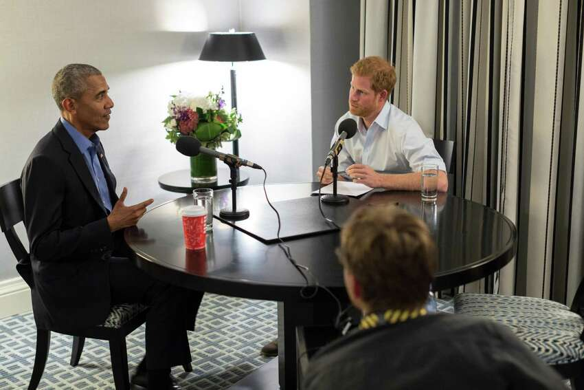 TOPSHOT - An undated handout picture issued by Kensington Palace courtesy of the Obama Foundation on December 17, 2017 shows Britain's Prince Harry (R) interviewing former US president Barack Obama (L) in Toronto, Canada as part of his guest editorship of BBC Radio 4's Today programme which is to be broadcast on the 27th December. Former US President Barack Obama told Britain's Prince Harry that he felt concern over the future of the US but a sense of
