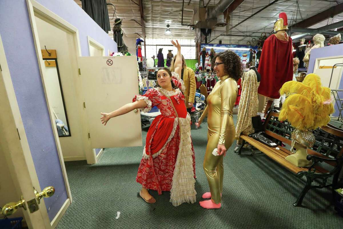 Corinne Villanueva (left) tries on a costume with friend Cassandra Morris at Frankel's Costume, an Houston institution, that closed their doors Wednesday, Dec. 27, 2017 as the owners are retiring. Everything was half-price and the owners will have a encore sale the first weekend in January.