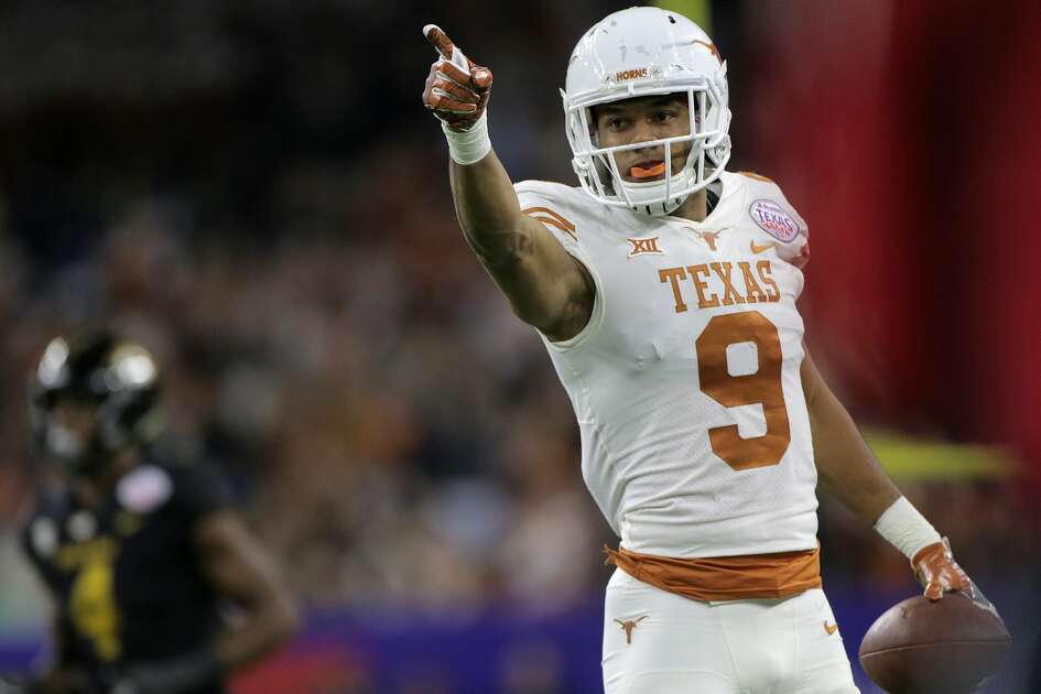 Texas Longhorns wide receiver Collin Johnson (9) points after catching a pass for a first down during The Academy Sports + Outdoors Texas Bowl between against Missouri at NRG Stadium on Wednesday, Dec. 27, 2017, in Houston. ( Elizabeth Conley / Houston Chronicle )