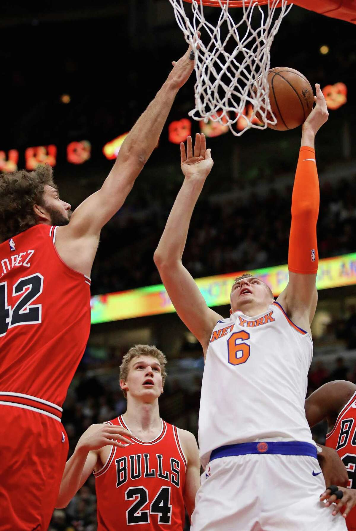 CHICAGO, IL - DECEMBER 27: Kristaps Porzingis #6 of the New York Knicks puts up a shot against Robin Lopez #42 of the Chicago Bulls at the United Center on December 27, 2017 in Chicago, Illinois. NOTE TO USER: User expressly acknowledges and agrees that, by downloading and or using this photograph, User is consenting to the terms and conditions of the Getty Images License Agreement. (Photo by Jonathan Daniel/Getty Images)