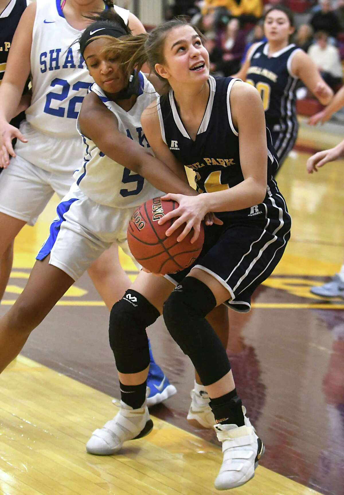 Averill Park's Anna Jankovic goes for the basket guarded by Shaker's Sole Carrington during a basketball game on Wednesday, Dec. 27, 2017 in Colonie, N.Y. (Lori Van Buren / Times Union)