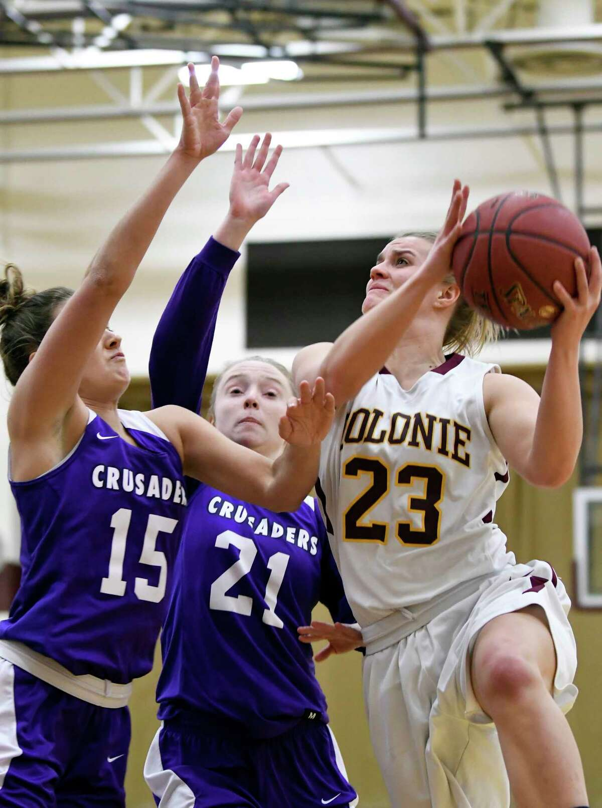 Catholic Central's Hannah Field (15) and Kay Valley (21) defend against Colonie's Erin Fouracre (23) during a girls high school basketball game on Wednesday, Dec. 27, 2017, in Colonie, N.Y. (Hans Pennink / Special to the Times Union)