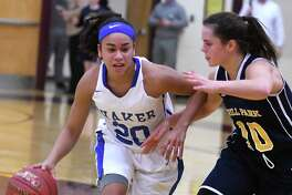 Shaker's Shyla Sanford drives to the hoop guarded by Averill Park's Stephanie Jankovic during a basketball game on Wednesday, Dec. 27, 2017 in Colonie, N.Y.  (Lori Van Buren / Times Union)