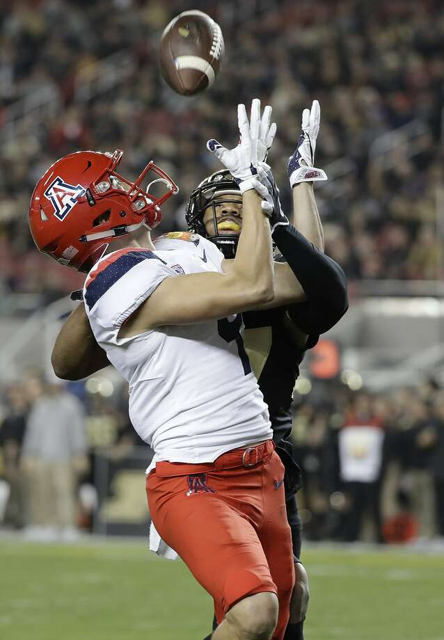 Arizona wide receiver Tony Ellison, left, makes a touchdown catch in front of Purdue safety Navon Mosley during the first half of the Foster Farms Bowl NCAA college football game Wednesday, Dec. 27, 2017, in Santa Clara, Calif. (AP Photo/Marcio Jose Sanchez) Photo: Marcio Jose Sanchez, Associated Press