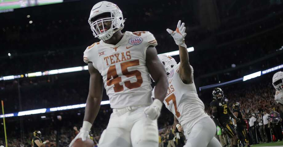 Texas Longhorns defensive back Antwuan Davis (7) celebrates Texas Longhorns linebacker Anthony Wheeler (45) fumble recovery for a touchdwon during the Academy Sports + Outdoors Texas Bowl against Missouri at NRG Stadium on Wednesday, Dec. 27, 2017, in Houston. ( Elizabeth Conley / Houston Chronicle ) Photo: Elizabeth Conley/Houston Chronicle