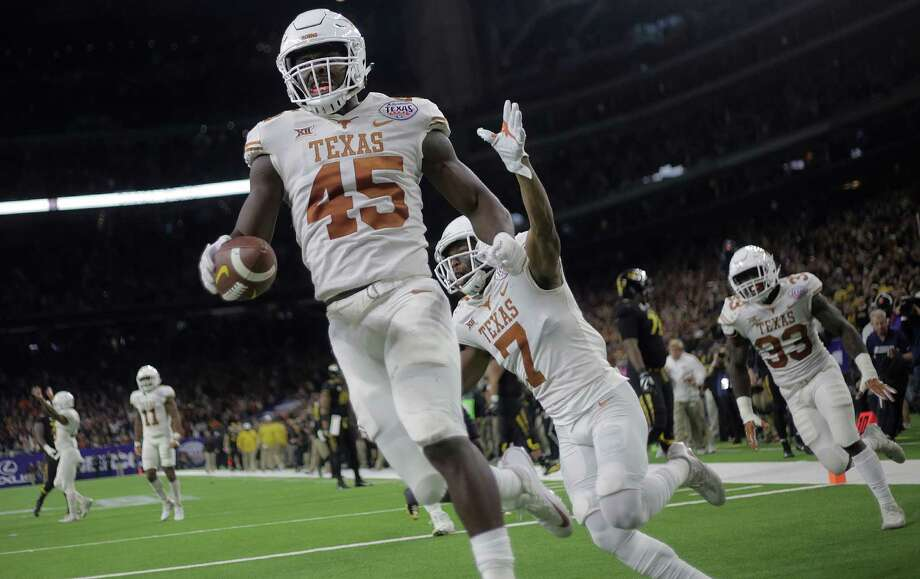 Texas defensive back Antwuan Davis (7) and Anthony Wheeler (45) celebrate after Wheeler's fumble recovery for a touchdown. Photo: Elizabeth Conley, Chronicle / © 2017 Houston Chronicle