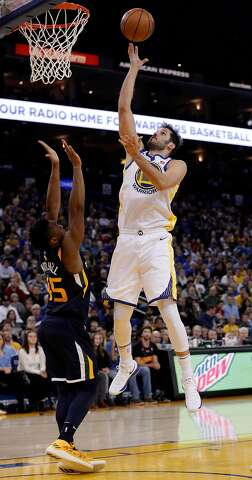 2ceb842467f Omri Casspi (18) shoots over Donovan Mitchell (45) in the second half