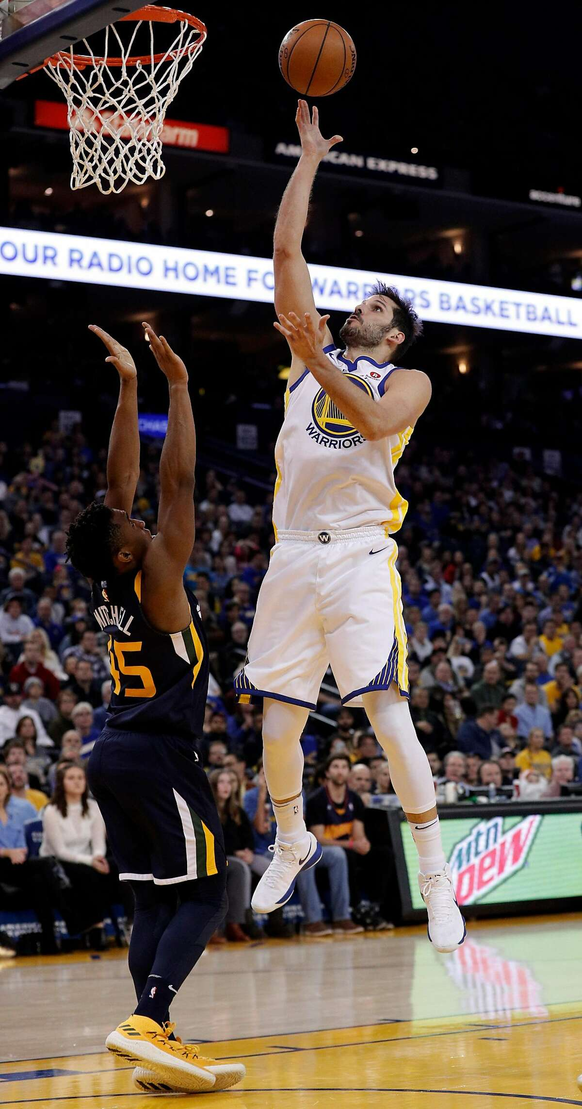 Omri Casspi (18) shoots over Donovan Mitchell (45) in the second half as the Golden State Warriors played the Utah Jazz at Oracle Arena in Oakland on Wednesday, Dec. 27, 2017.