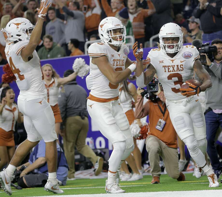 Texas Longhorns wide receivers Lorenzo Joe (14) and Collin Johnson (9) celebrate Texas Longhorns wide receiver Armanti Foreman (3) touchdown in the fourth quarter during the Academy Sports + Outdoors Texas Bowl against Missouri at NRG Stadium on Wednesday, Dec. 27, 2017, in Houston. Texas won the game 33-16. ( Elizabeth Conley / Houston Chronicle ) Photo: Elizabeth Conley/Houston Chronicle