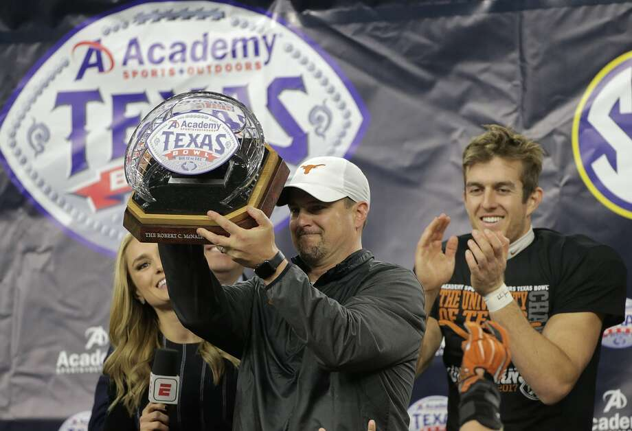 PHOTOS: A look at Texas' win over Missouri in the Texas BowlTexas Longhorns head coach Tom Herman holds up the trophy with Texas Longhorns punter Michael Dickson (13) behind him after The Academy Sports + Outdoors Texas Bowl against Missouri at NRG Stadium on Wednesday, Dec. 27, 2017, in Houston. Texas won the game 33-16. ( Elizabeth Conley / Houston Chronicle ) Photo: Elizabeth Conley/Houston Chronicle