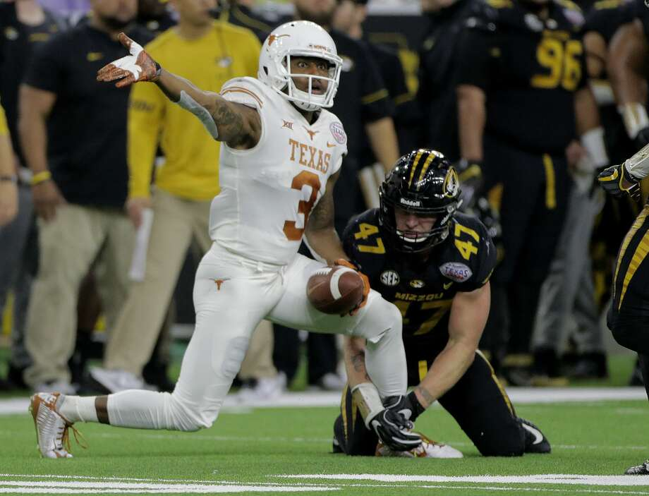 Texas Longhorns wide receiver Armanti Foreman (3) makes the sign for a first down while Missouri Tigers linebacker Chance May (41) still holds onto his leg during the Academy Sports + Outdoors Texas Bowl at NRG Stadium on Wednesday, Dec. 27, 2017, in Houston. Texas won the game 33-16. ( Elizabeth Conley / Houston Chronicle ) Photo: Elizabeth Conley/Houston Chronicle