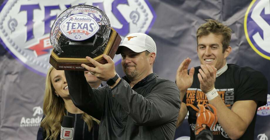 Texas Longhorns head coach Tom Herman holds up the trophy with Texas Longhorns punter Michael Dickson (13) behind him after The Academy Sports + Outdoors Texas Bowl against Missouri at NRG Stadium on Wednesday, Dec. 27, 2017, in Houston. Texas won the game 33-16. ( Elizabeth Conley / Houston Chronicle ) Photo: Elizabeth Conley/Houston Chronicle