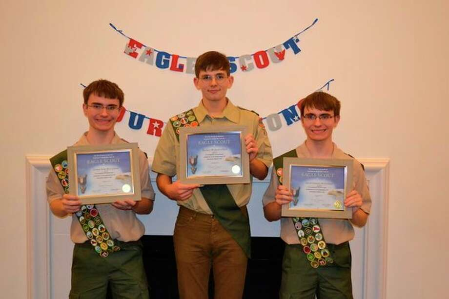 Three local young men from Memorial Presbyterian Church Troop 765 recently earned the rank of Eagle Scout: Twins, Jacob and Joshua McClelland, and Zachary O'Dell, center. (Photo provided)