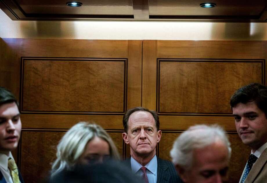 Sen. Patrick J. Toomey crowds into elevator for votes on the Senate floor on Dec. 6. Photo: Washington Post Photo By Melina Mara / The Washington Post