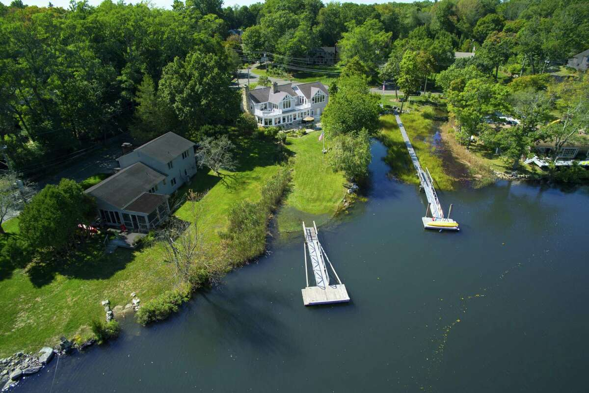 This property enjoys 91 feet of waterfrontage along the Five Mile River and a private dock.