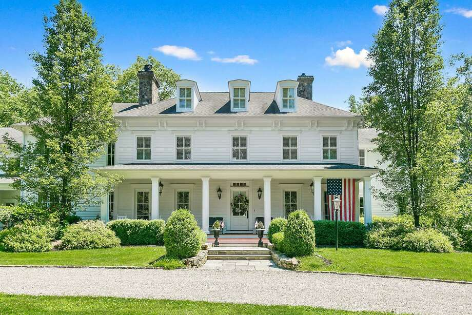 The classic colonial house at 12 Sunnyside Lane is on a property of nearly three acres and has a long, covered front porch. It is also ADA-compliant and has an elevator.