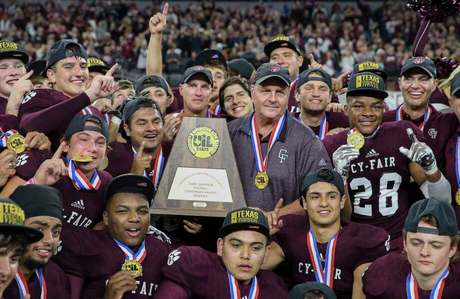 Cy-Fair Head Coach Ed Pustejovsky and his team pose for a photo with the state title plaque after winning the Class 6A Division II State Championship Game at AT&T Stadium on Saturday, Dec. 23, 2017, in Arlington. The Cy-Fair Bobcats defeated the Waco Midway Panthers 51-35 and won the state championship title. ( Yi-Chin Lee / Houston Chronicle ) Photo: Yi-Chin Lee, Houston Chronicle / © 2017  Houston Chronicle
