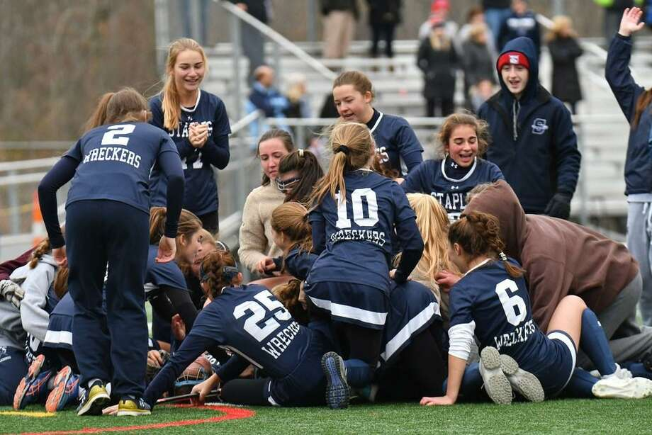 Top, members of the Staples field hockey pile on one another after winning the Class L state title in a 1-0 win over Darien on November 18. Bot, Staples baseball team celebrate after upsetting three-time defending Class LL state champions Amity 5-1 for the Wreckers first state title since 2001. Photo: Gregory Vasil / Hearst Connecticut Media