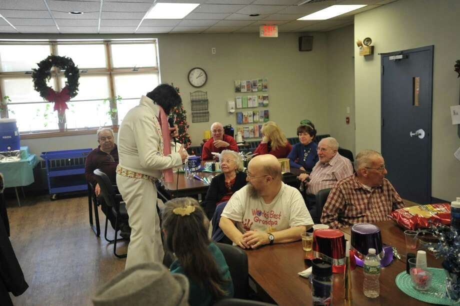 "Winsted residents celebrated the coming New Year Wednesday afternoon, coming together for festivities at the Blanche McCarthy Senior Center that included a performance from ""Elvis."" Photo: Ben Lambert / Hearst Connecticut Media"