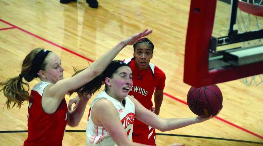 Kate Martin drives to the basket against Kirkwood.