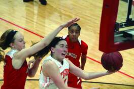 Kate Martin drives to the basket against Kirkwood.