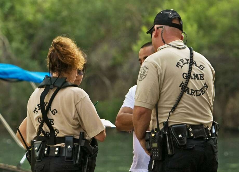 Game wardens' routine checks of boaters' safety equipment can prevent accidents and drowning or lead to a boating while intoxicated arrest or a citation for violating fishing laws. Photo: John Goodspeed /