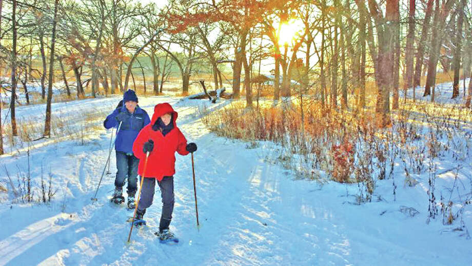 Snowshoeing through Conservation District land is just one of  the winter outdoor recreation activities in McHenry County, Ill. Photo: For The Edge