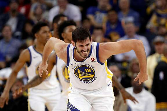 Omri Casspi (18) grimaces after injuring his ankle in the second half as the Golden State Warriors played the Utah Jazz at Oracle Arena in Oakland, Calif., on Wednesday, December 27, 2017.