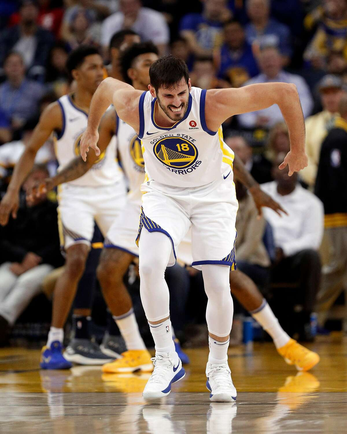 Omri Casspi (18) grimaces after injuring his ankle in the second half as the Golden State Warriors played the Utah Jazz at Oracle Arena in Oakland on Wednesday, Dec. 27, 2017.