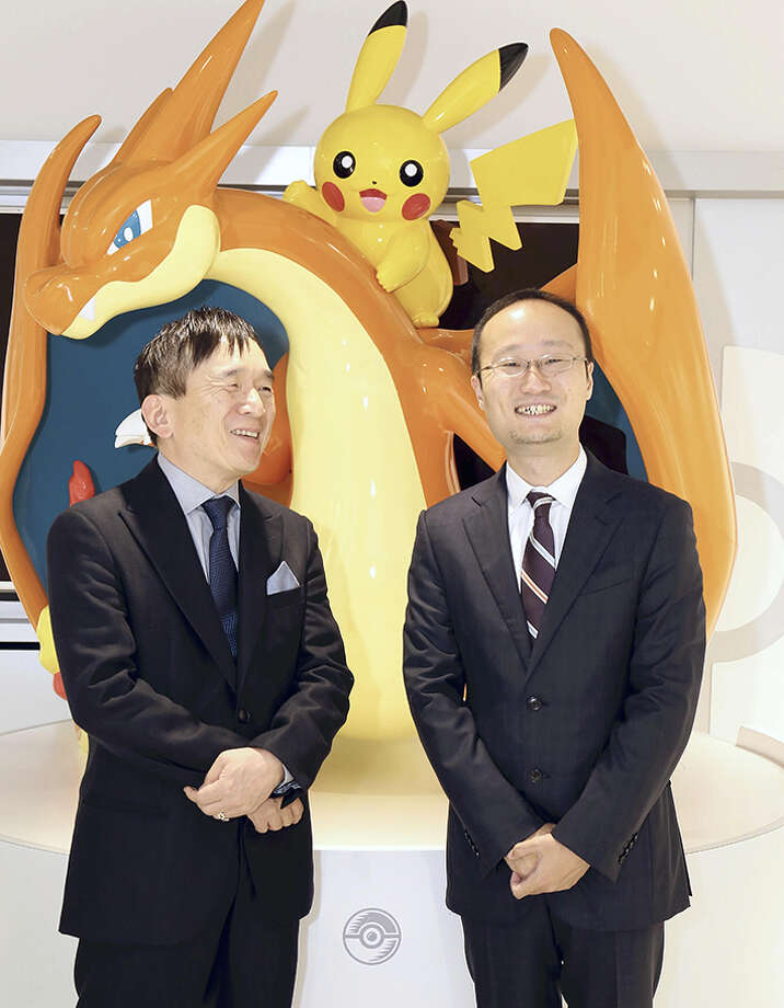 Tsunekazu Ishihara, left, and Akira Watanabe smile at Pokemon Center Mega Tokyo. Photo: Japan News-Yomiuri Photo / Japan News-Yomiuri