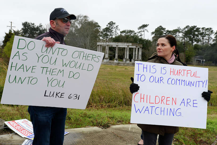 Jeremy and Tracie Parzen hold protest signs near the Confederate Memorial of the Wind in Orange on Wednesday. The unfinished memorial is being built by the Sons of Confederate Veterans next to Interstate 10.  Photo taken Wednesday 12/27/17 Ryan Pelham/The Enterprise Photo: Ryan Pelham / ©2017 The Beaumont Enterprise/Ryan Pelham