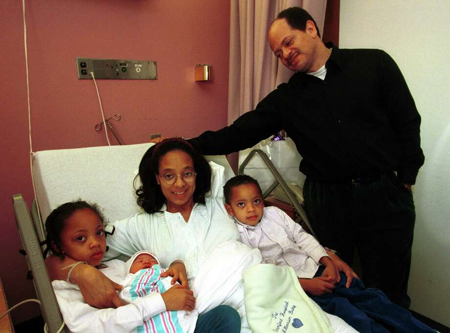 The Duboulay family at Stamford Hospital, from left, Allie, 6, Catherine, the year's first baby, mother Althea, Zachary, 4, and father Donald. Catherine was born at 12:37 a.m. on Jan. 1, 2000. Photo: Andrew Sullivan / File Photo