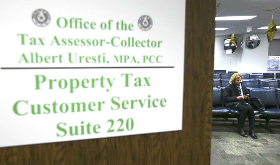 Susan Bowman waits Thursday, Dec. 28, 2017 at the tax assessor's office to pay the remainder of her 2017 property taxes. Bowman originally came to the tax office to also prepay her estimated 2018 taxes in advance of the new tax rules that go into effect January 1. She changed her mind about prepaying for 2018 after learning the IRS issued a guideline late Wednesday saying it would not allow deductions on 2017 taxes for prepayment of estimated 2018 taxes. Photo: William Luther, Staff / San Antonio Express-News / © 2017 San Antonio Express-News