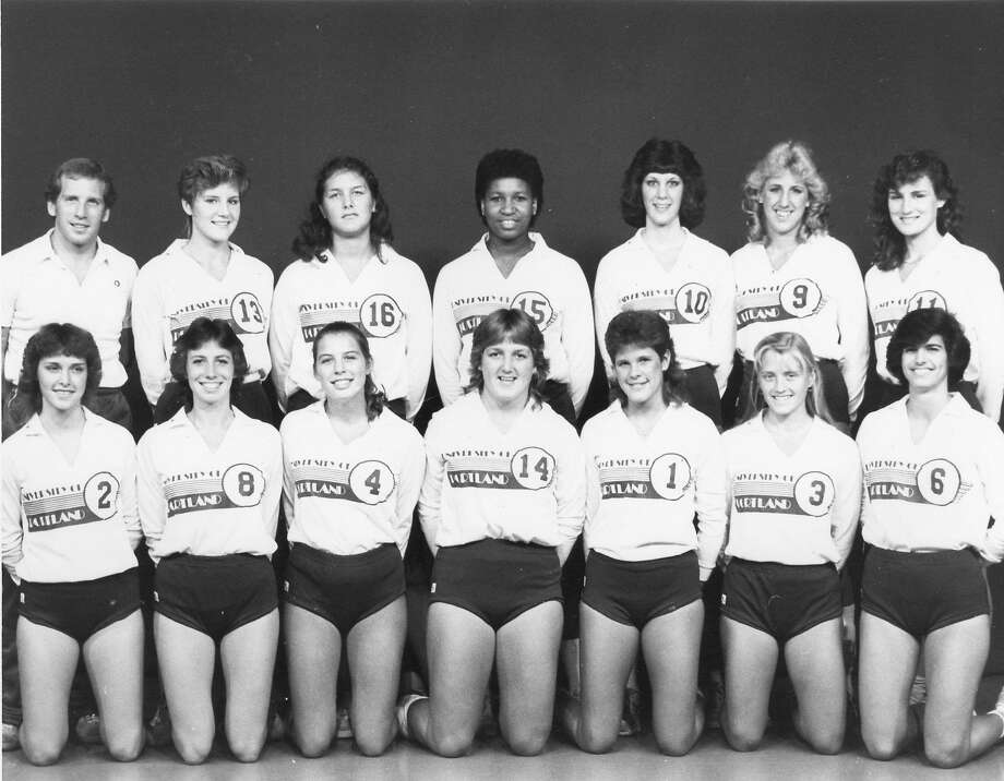 Team photo for Volleyball players Julie (#11) upper right, is the mother of Golden State Warriors player Klay Thompson