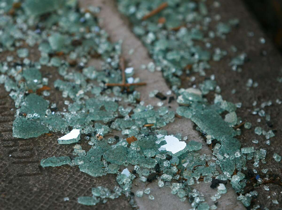 Shattered glass from a recent car break-in remains on the sidewalk on Bay Street near Kearny Street in San Francisco, Calif. on Wednesday, Sept. 9, 2015.