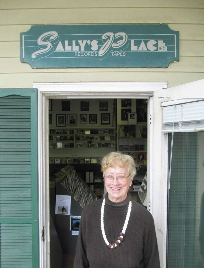 Pictured is Sally White, owner of Sally's Place, a music shop on Westport's Main Street that has continued to thrive despite the fact many people download their music nowadays. White says it's all about customer service. Photo: Contributed Photo / ST / Westport News