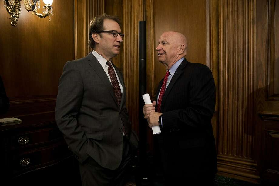 Rep. Peter Roskam, a Republican from Illinois, speaks with Rep. Kevin Brady, a Republican from Texas, right, prior to a Tax Cuts and Jobs Act enrollment ceremony at the U.S. Capitol in Washington, D.C., on Thursday, Dec. 21, 2017. Republicans want to channel momentum from the GOP's victory on taxes into a push to overhaul the nation's welfare programs, though some of President Trump's advisers prefer a less controversial infrastructure plan at the top of his agenda. Photo: Aaron P. Bernstein, Bloomberg