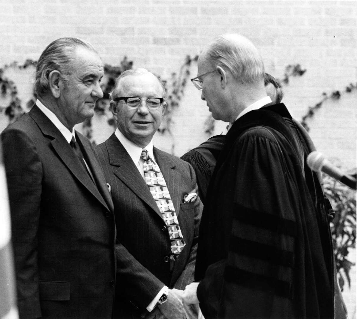 Lyndon Johnson, left, with Perry Bass, center, and J.M. Moudy, right attend an event at Texas Christian University in Fort Worth, Texas, in April 1971. (Photo Courtsey University of Texas Archives Special Collections/Fort Worth Star-Telegram/KRT)